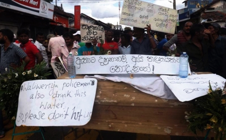 Weliweriya protesters with Handwritten Placards - one says Nadungamuwa Raja - a tusker honored by carrying Dalada Karaduwa that was stationed in close proximity stopped drinking well water for few weeks