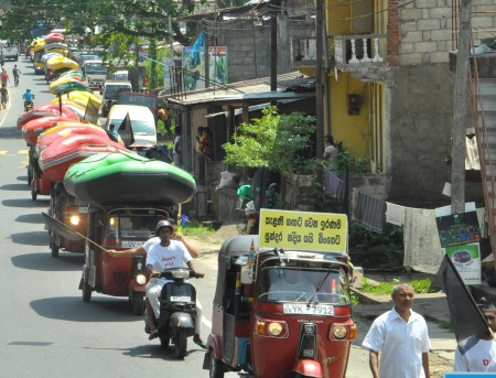 Protesting with their rafts on top of 3-wheelers